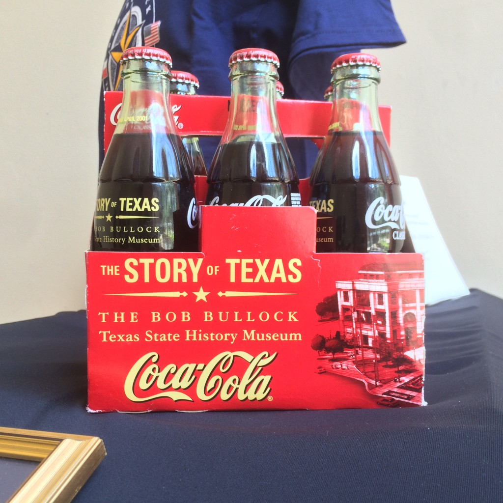 A commemorative six-pack of Coca-Cola printed with the museum's logo, name, and mission.