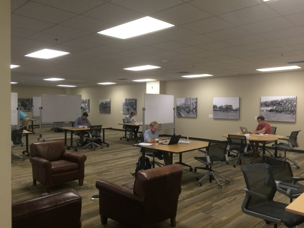The new Incubator features amenities like lighted workstations, whiteboard, and moveable desks.