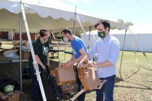 Staff members help tear down cardboard boxes.