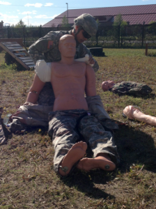 Cadet Hutchison helps set up the Expert Field Medic Badge course.