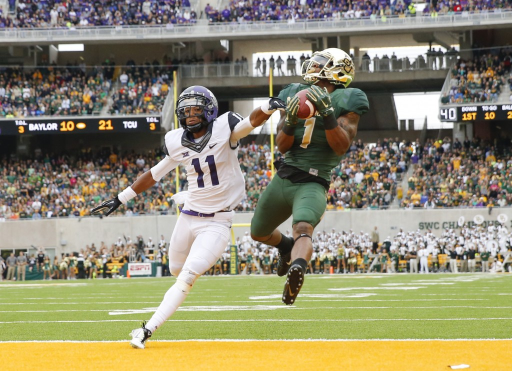 Oct 11, 2014; Waco, TX, USA; Baylor Bears wide receiver Corey Coleman (1) catches a touchdown pass over TCU Horned Frogs cornerback Ranthony Texada (11) during the first half at McLane Stadium. Mandatory Credit: Kevin Jairaj-USA TODAY Sports