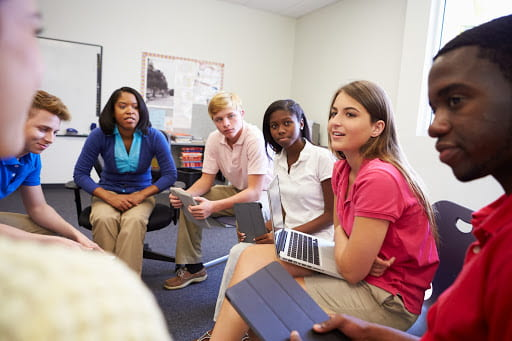 Image of young adults working with a healthcare professional