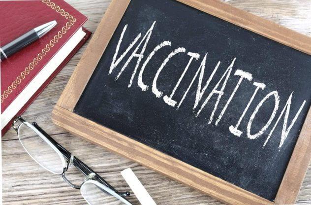 Chalkboard with 'vaccine' written on it.