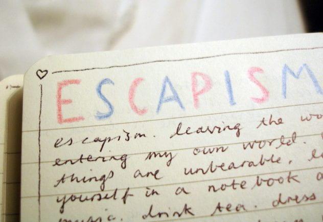 """""""Escapism"""" written on a notepad."""