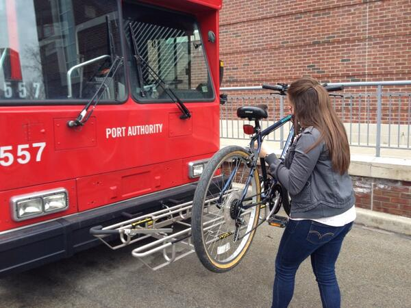 Sarah, a Chatham College for Women student and Bike PGH intern, learning how to use the bike racks on a Pittsburgh Port Authority bus!