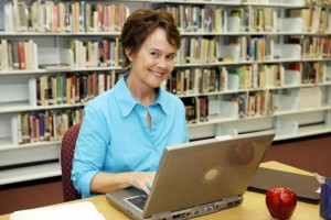 bigstock-A-pretty-librarian-working-on--11982029
