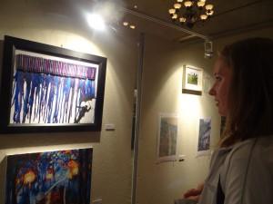 Photo Courtesy of Alice Shy First Year Jilene Penhale admiring student artwork