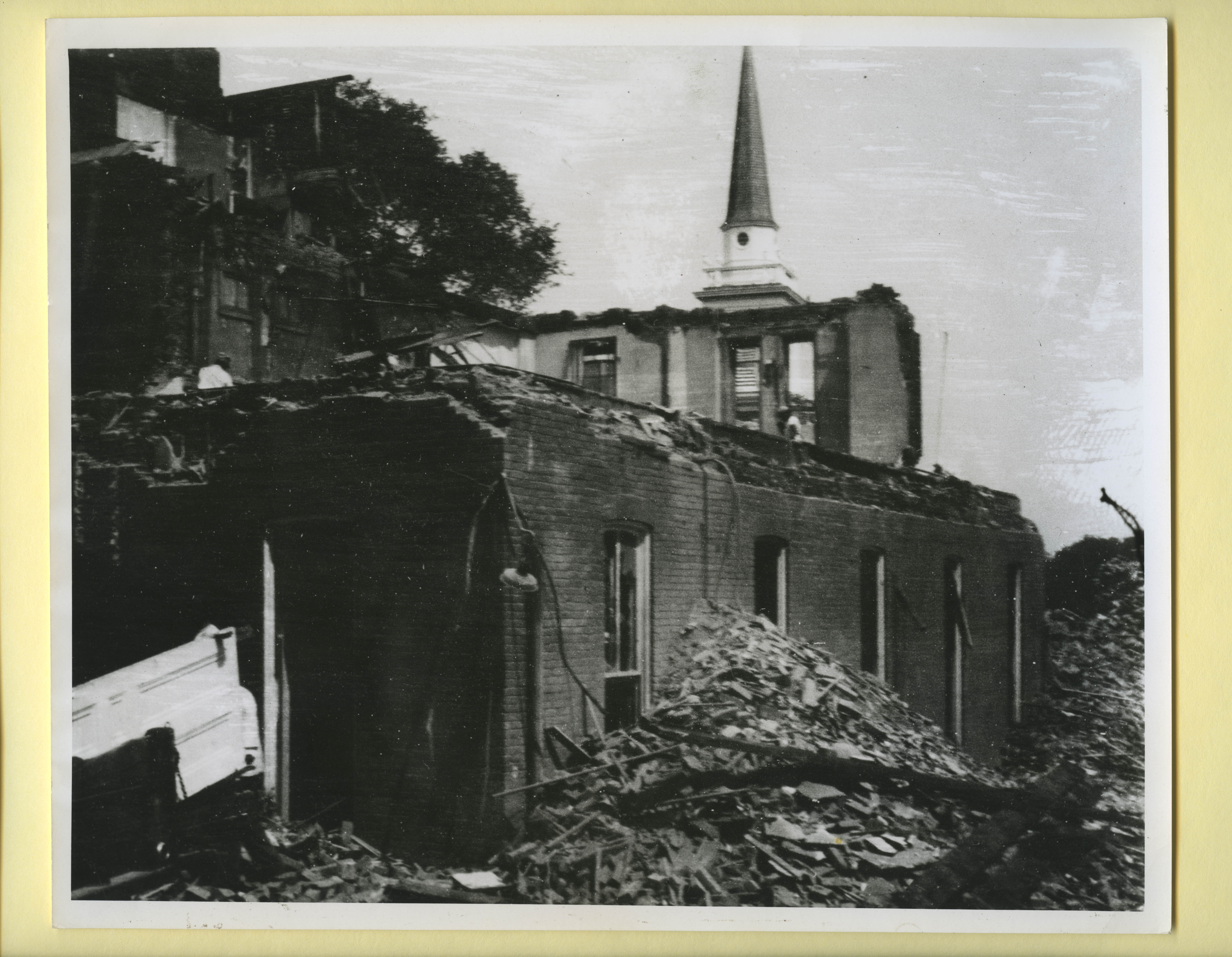 View of Berry Hall I and Dilworth Hall I during demolition with Chapel steeple visible in background