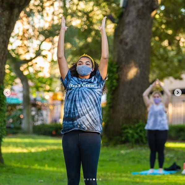 Student participating in Friday yoga at the Cistern.