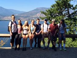 iCHS Kelowna students taking a break to admire the views of Okanagan Lake while hiking Knox Mountain.