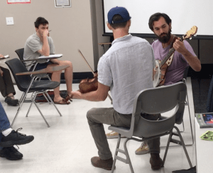 Fiddle and banjo players in classroom