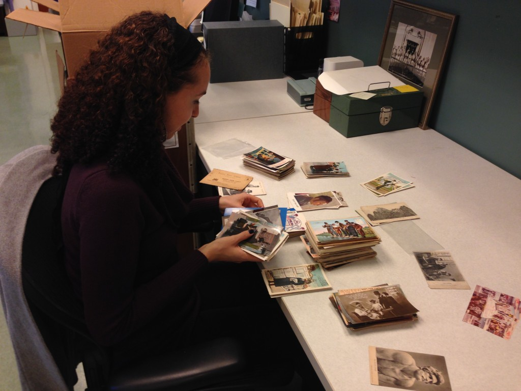 Processing Archivist Amy Lazarus organizing Rosh Hashanah postcards.