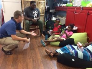 engineer speaks with children