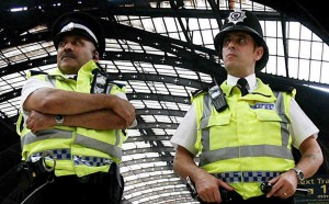 Two British police officers on special duties  at Paddington Station west London, 2 July 2007. EPA/ANDY RAIN