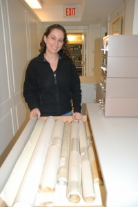 Melissa Bronheim processing architectural drawings from the H. A. DeCosta Papers.