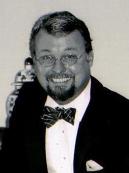 headshot of Denis Keyes
