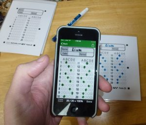 cell phone scanning a bubble answer sheet