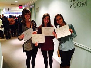 CofC student delegates holding their awards