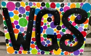 Colorful artwork featuring the letters 'WGS' - designed for the program by Beth Haas