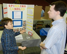 Student presenting his science fair project to one of our judges.