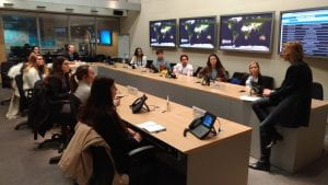 Dr. Bossak and public health students in the WHO Situation Room