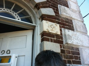 Close up of the quoins and fanlight over the front entry.