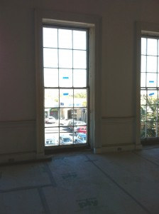 Eight foot tall double hung nine over nine window sash overlooking East Bay Street.