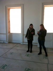Callie Beal and Sarah Gumenick review their photographs in the upstairs ball room.