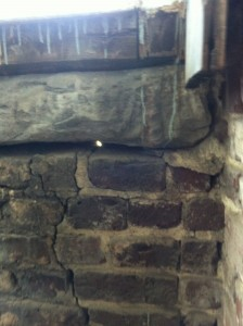 One of surprisingly few cracks in the masonry, and a stone window sill.