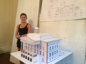 Madison Mauck shows off a very classical architectural model.