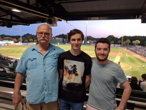 Left to right: Jim Bowring, Maël Gaonach, and Meven Turmel at a River Dogs game.