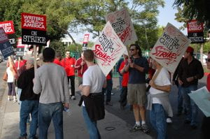 A crowd of union members holding signs