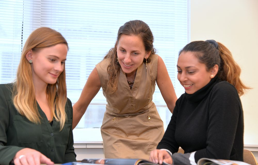 Joanna M. Bauza (MBA '01) (center), president of the Cervantes Group, teaches a course in leadership at DePaul.