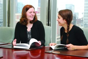 Colleen Fashing, associate director of alumni relations, advises a student about the Corporate Connectors program.