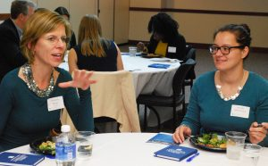 Maureen Meyer (BUS '90) provides career advice at a Dinner on DePaul event for finance students.
