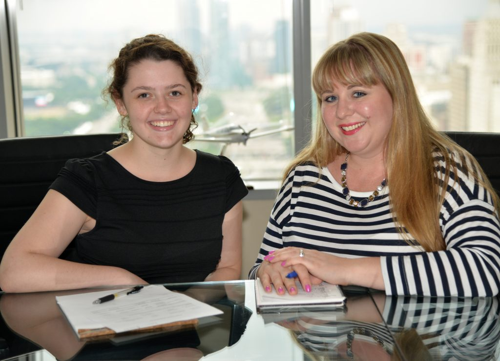 Accounting Manager Amanda Rzepka and Allison Fisher, a DePaul accounting major.