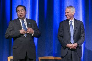 Dr. Gabriel Esteban and Jim Ryan, trustee and chair of the Presidential Search Committee, share a laugh as they chat about tie colors on stage Thursday, February 16, 2017, at the Student Center on the Lincoln Park Campus. Dr. Esteban was named the university's 12th president during a day of welcoming events at both the Loop and Lincoln Park Campuses. (DePaul University/Jamie Moncrief)