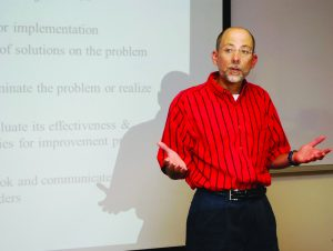 Instructor Philip Gisi teaches a course on Six Sigma.