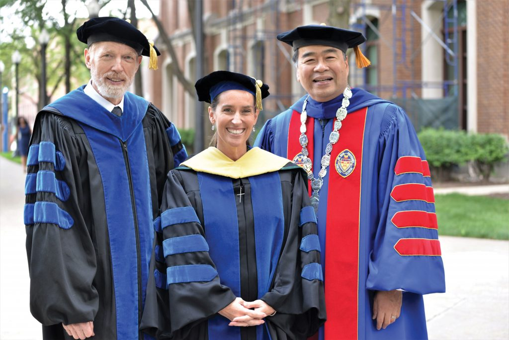 DePaul Provost Marten denBoer, Business Dean Misty Johanson, and DePaul President A. Gabriel Esteban at Convocation.
