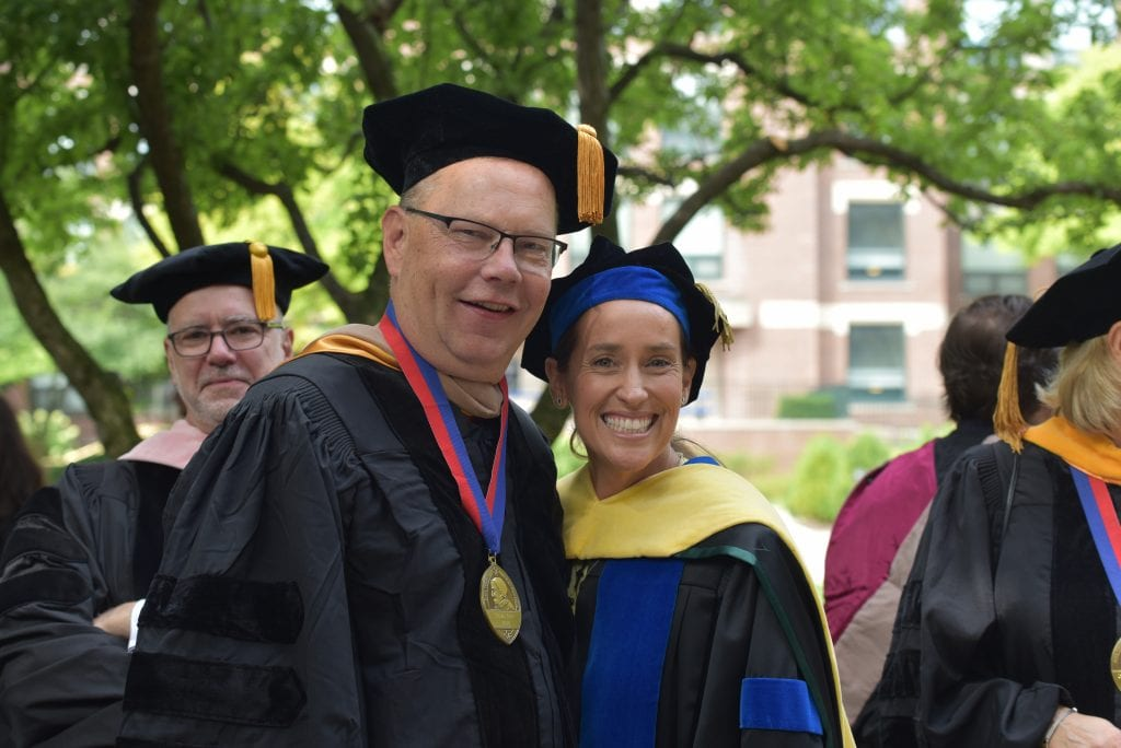 Tom Berry, finance professor and ​associate dean for faculty and student success, and Dean Misty Johanson at Academic Convocation.