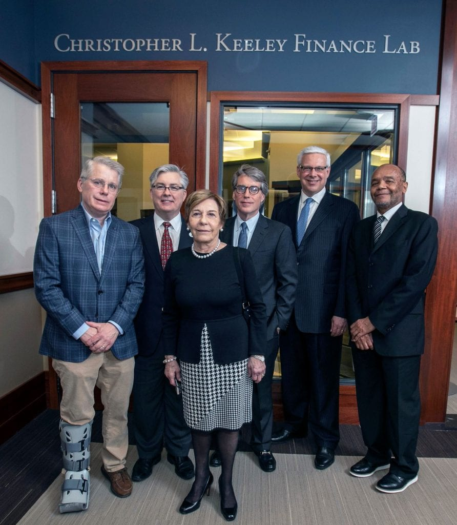 Members of the Keeley family (left to right)—John Keeley III, Kevin Keeley, Barbara Keeley and Mark Keeley—join Martin Essenburg, executive director of the John L. Keeley Center for Financial Services, and Elijah Brewer, department of finance chair, following the dedication of the Christopher L. Keeley Finance Lab. Photo: Jamie Moncrief