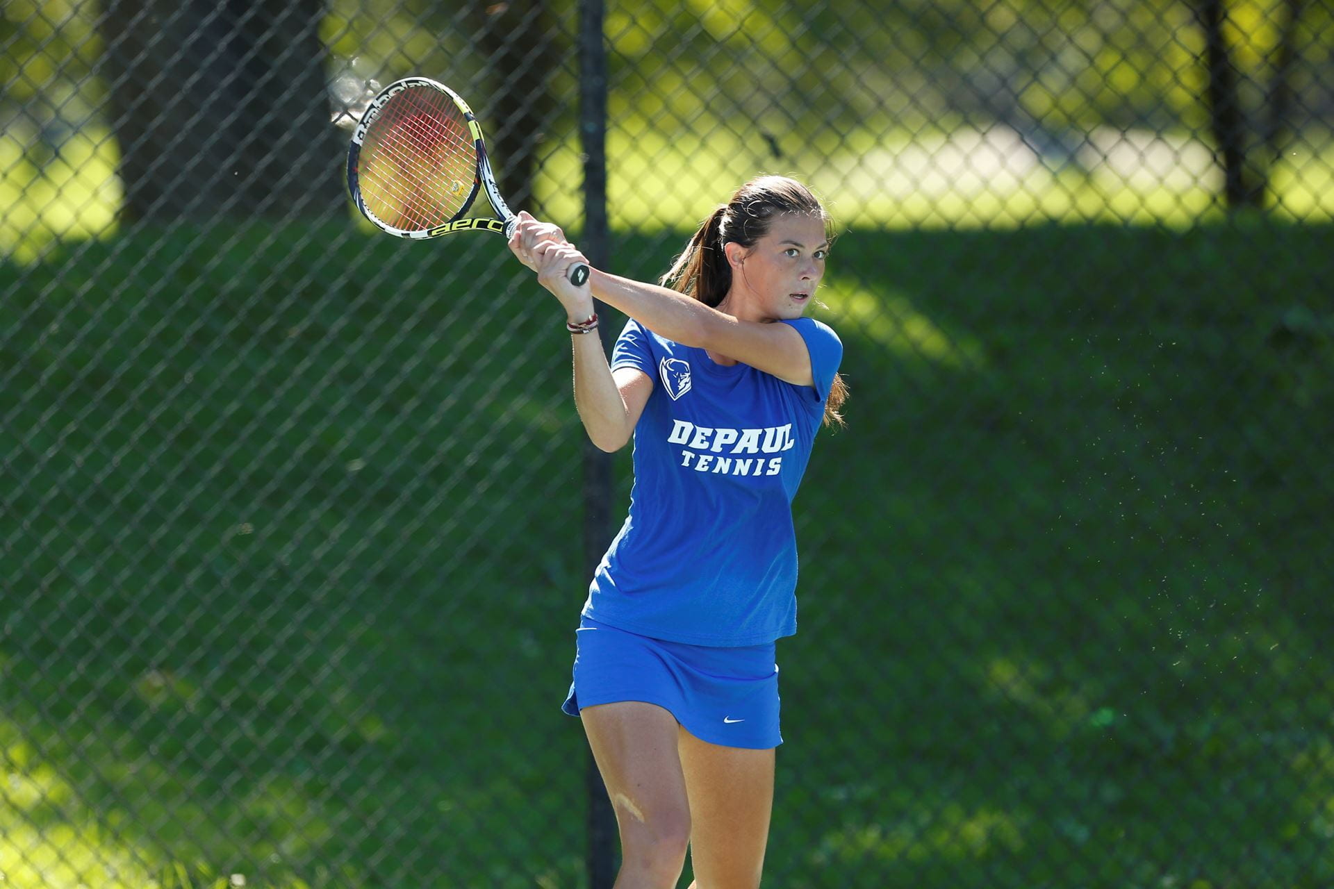 Rebeca Mitrea playing for DePaul University's women's Division I tennis team