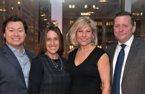 The Driehaus College of Business celebrated the launch of a new digital marketing concentration in its undergraduate marketing major. From left to right: John Digles, Business Dean Misty Johanson, Jacqueline Kuehl (BUS '87, MBA '95) and Steve Koernig (MBA '94).