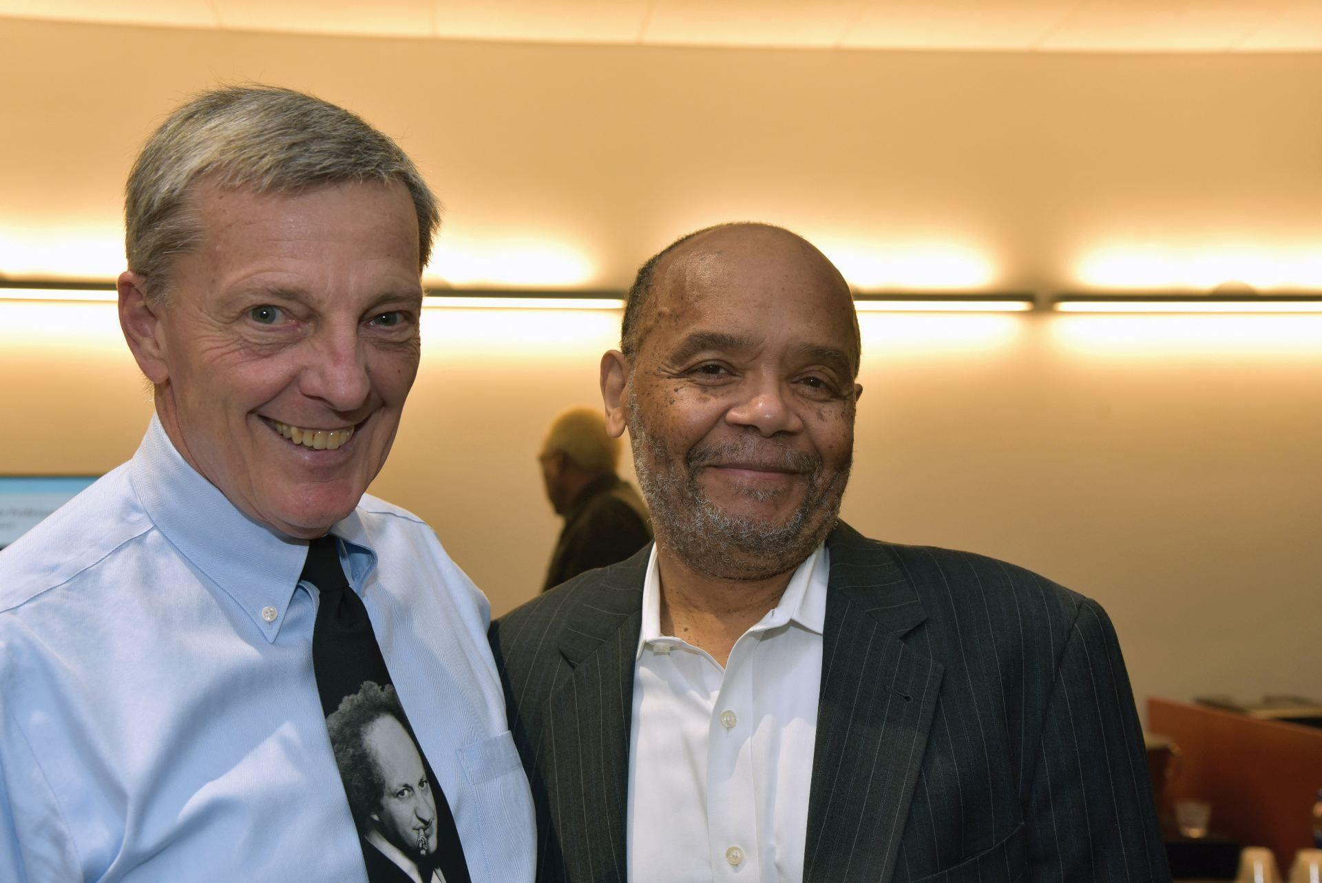 Finance Chair Eli Brewer (right) congratulates retiree Finance Associate Professor Carl Luft.