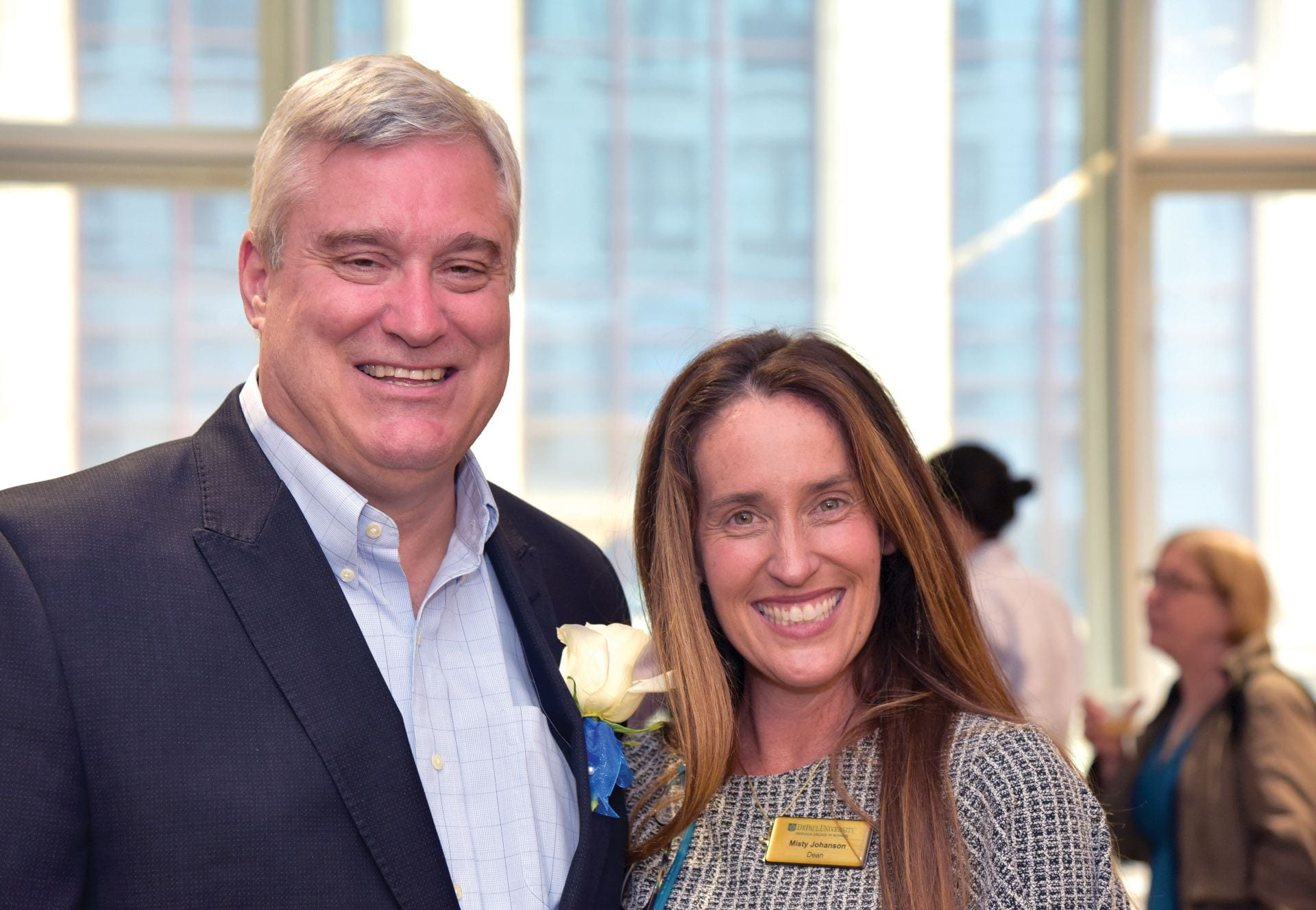 Management Chair Dan Heiser celebrates his appointment as St. Norbert College business dean with DePaul Business Dean Misty Johanson.