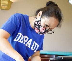 So Hui Nye (pictured) takes the lead on production while Lauren Pingad manages operations and marketing for their company Fashion Masks, which sells premium quality face masks.