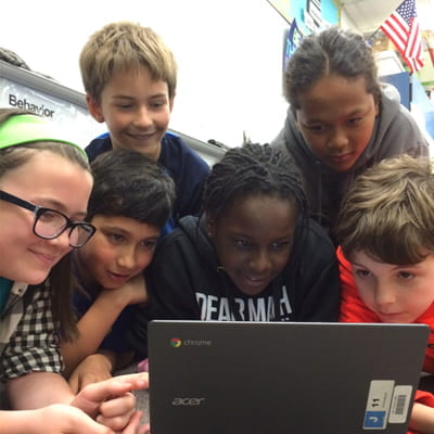 Photo of EGUSD students in front of chromebook
