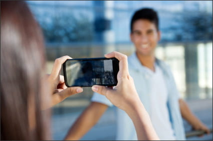 students using cell phone for photo