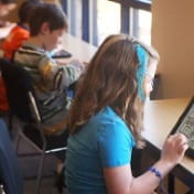 Photo of students using tablets