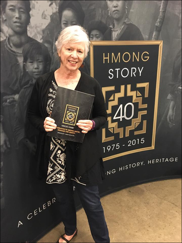 Gail Desler at the exhibit entrance to Hmongstory 40 Merced